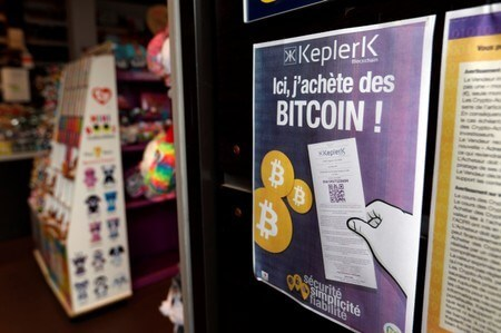 A placard of French startup Keplerk, for clients to purhcase bitcoins, is seen inside a tobacco shop Bitcoin